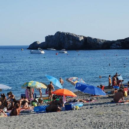 People enjoying the Marina del Este beach